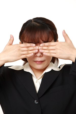 covering: businesswoman covering her face