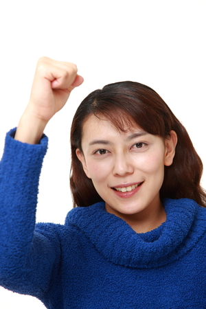 unattractive: asian woman in a victory pose