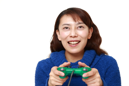 unattractive: asian woman enjoying a video game