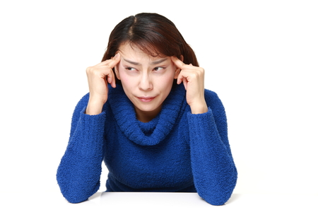 suffers: Japanese woman suffers from headache
