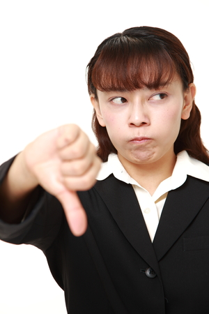 unattractive: asian businesswoman with thumbs down gesture