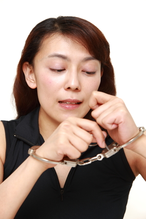 arrest women: Woman trying to free herself Stock Photo