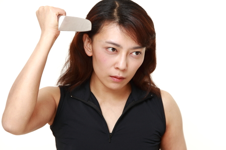 female assassin: killer woman with knife Stock Photo