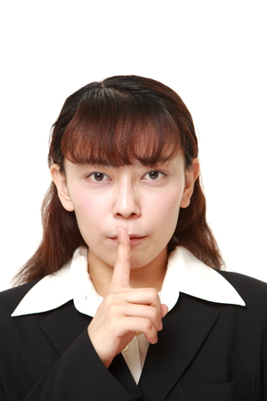 gestures: asian businesswoman whith silence gestures Stock Photo