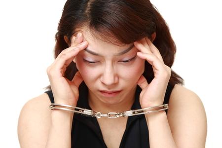 hoodlum: arrested woman Stock Photo