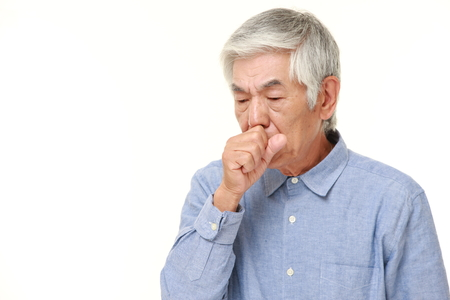 coughing: senior Japanese man coughing