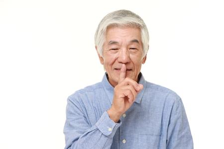 gestures: senior Japanese man whith silence gestures