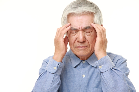 headache pain: senior Japanese man suffers from headache