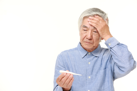 70s adult: senior Japanese man with fever Stock Photo