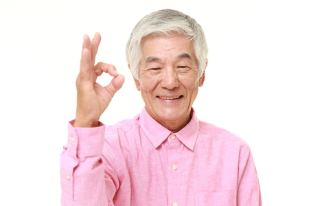 perfect sign: senior Japanese man showing perfect sign