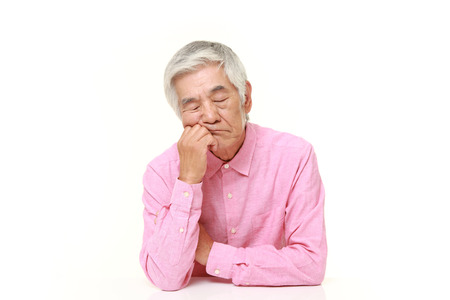 old asian: senior Japanese man sleeping on the table Stock Photo