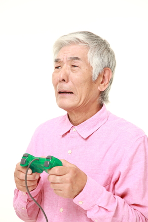 wimp: senior Japanese man losing playing video game