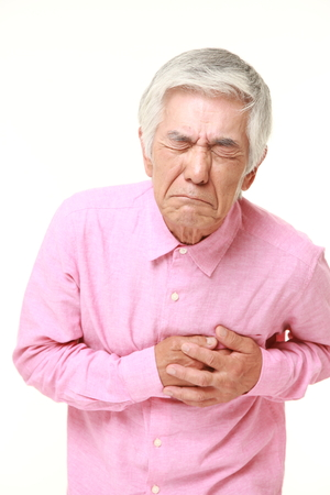 senior pain: senior Japanese man heart attack