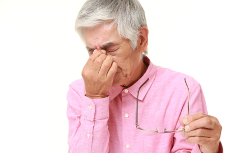 suffers: senior Japanese man suffers from Asthenopia