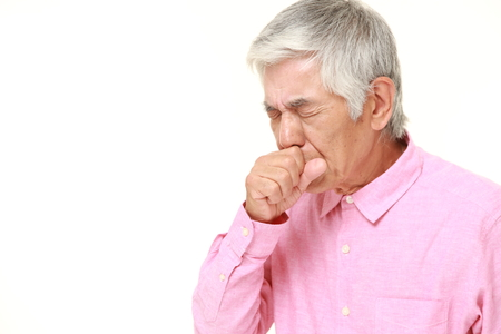 senior pain: senior Japanese man coughing