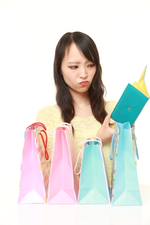 wasteful: wasteful Japanese woman with empty wallet
