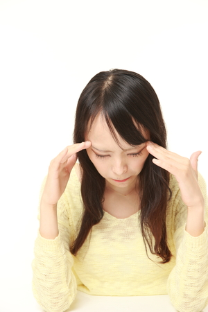 eyestrain: woman suffers from headache
