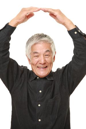 japanese people: senior Japanese man making OK gesture Stock Photo