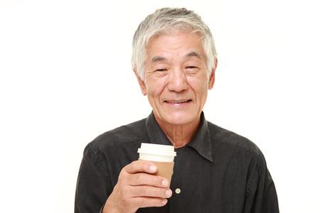 senior Japanese man takes a coffee break