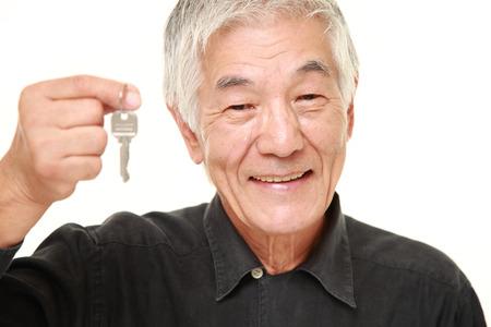 elderly man: senior Japanese man with home key Stock Photo