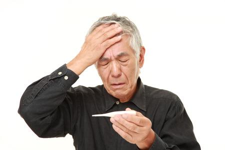 Senior Japanese man with fever