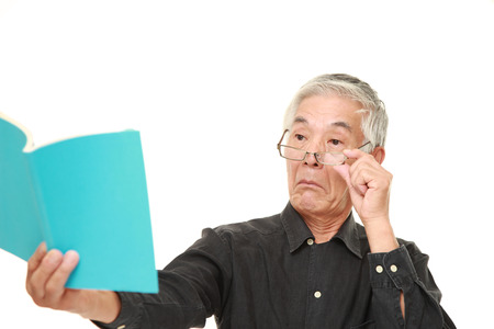 senior Japanese man with presbyopia Фото со стока - 45669626