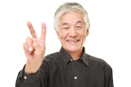 old man happy: senior Japanese man showing a victory sign Stock Photo