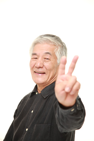 senior Japanese man showing a victory sign Stock Photo