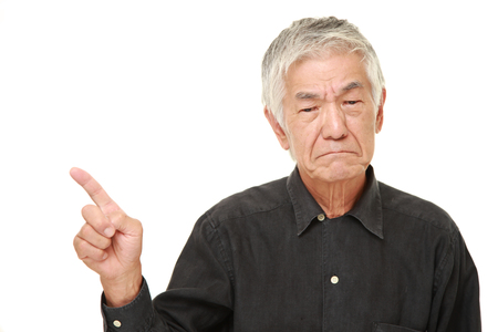 asian old man: senior Japanese man doubting