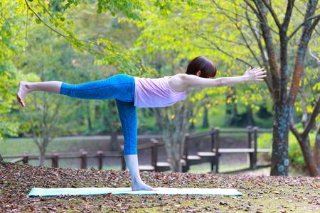 iii: Japanese Woman Doing YOGA warrior III pose Stock Photo