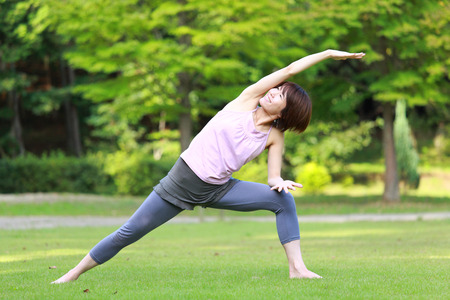 side angle pose: Japanese Woman Doing YOGA Extended Side Angle Pose