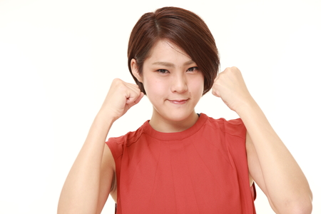 asian style: young Japanese woman in a victory pose Stock Photo