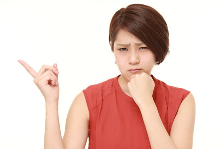 nonchalant: young Japanese woman doubting