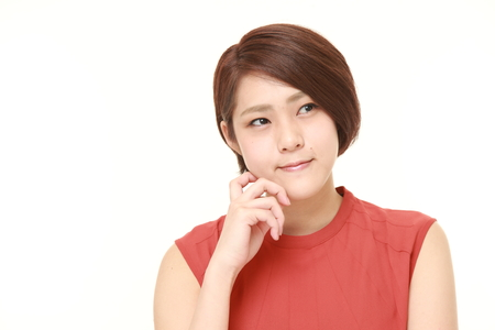 asia business: young Japanese woman thinks about something