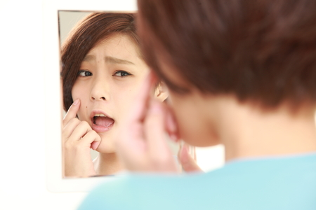 problem: young Japanese woman worries about dry rough skin Stock Photo