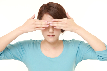 hands covering face: woman covering her face with hands Stock Photo