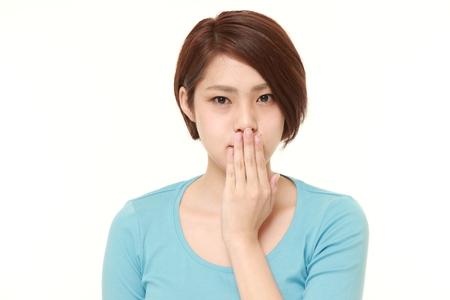 Japanese woman making the speak no evil gesture Stock Photo - 47803517