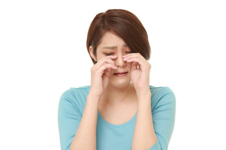 cries: young Japanese woman cries