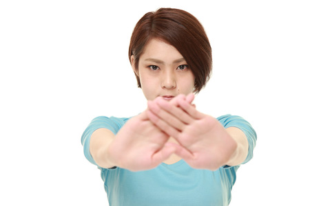 woman stop: young Japanese woman making stop gesture
