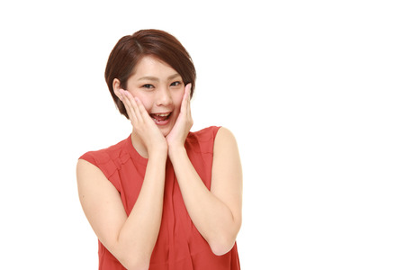 pleased: young Japanese woman pleased