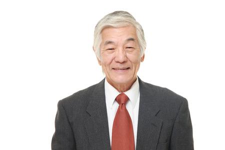 honestidad: Hombre de negocios mayor sonrisas japoneses Foto de archivo