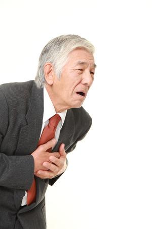 seniors suffering painful illness: senior Japanese businessman heart attack