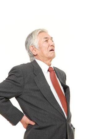 lumbago: senior Japanese businessman suffers from lumbago