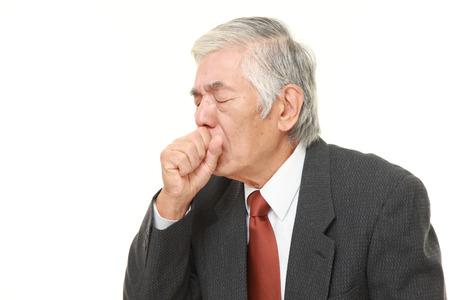 coughing: senior Japanese businessman coughing
