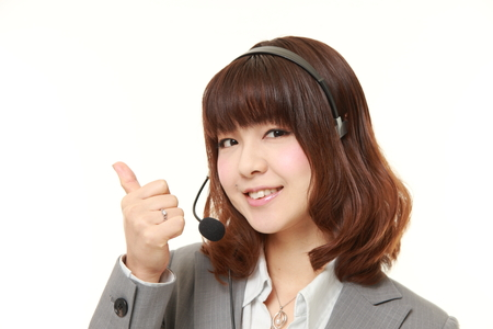 thumbs up: businesswoman with thumbs up gesture Stock Photo