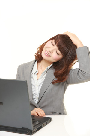 young businesswoman doing self neck stretch
