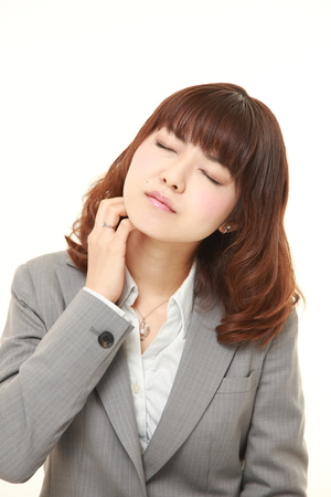 scratching: Japanese businesswoman scratching her neck Stock Photo
