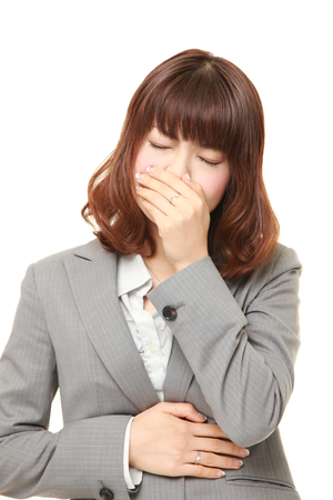 young Japanese businesswoman feels like vomiting