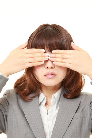 hands covering face: businesswoman covering her face with hands