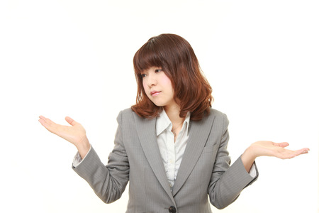 nonchalant: Japanese businesswoman confused